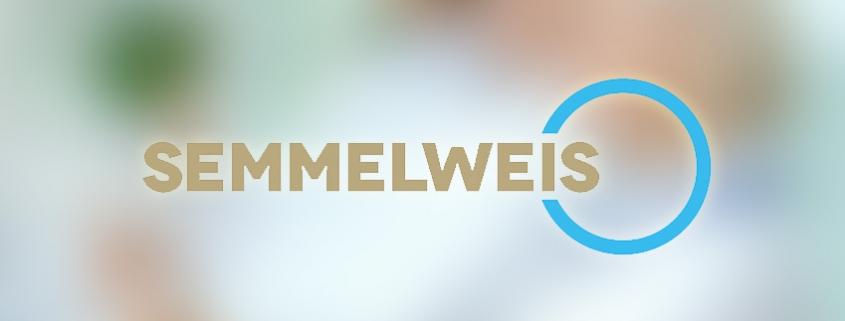 Verschwommenes Bild mit dem Semmelweis-Logo im Vordergrund
