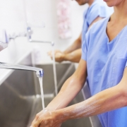 Two medical colleagues washing their hands before an operation