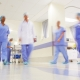 Picture of doctors working in a busy hospital corridor