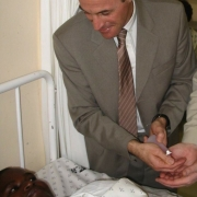 Prof. Didier Pittet with an Ebola infected african child