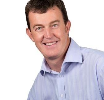 Portrait of Prof. Matt Cooper wearing a blue shirt