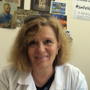 Portrait of Prof. Rossitza Vatcheva-Dobrevska in a doctor's white coat