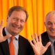 Picture of Bernhard Küenburg and Didier Pittet waving hands at the CEE Conference