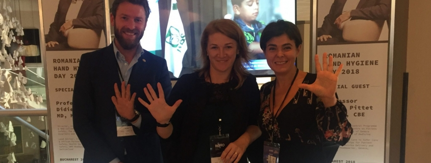 Picture of Dr. Andreea Moldovan and two other people showing their palm into the camera
