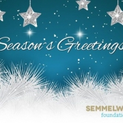 "blue Card with the Semmelweis foundation Logo and the text ""Season's Greetings!"" on it"